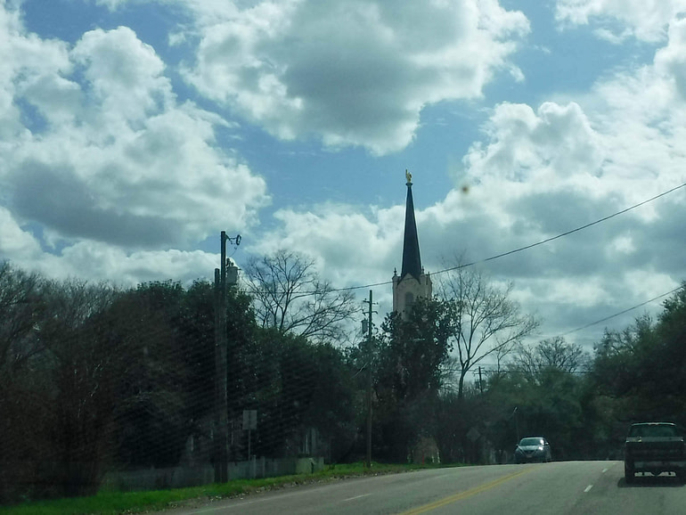 steeple with gold finger